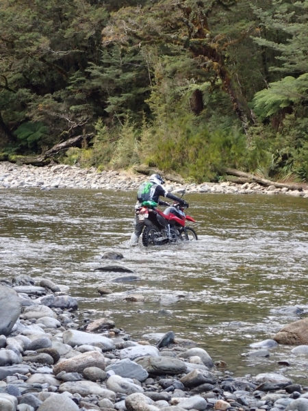 Crossing the Mackley River on Denniston Track