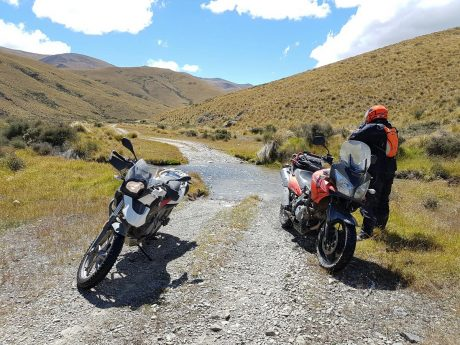 Riders take a break after crossing a small ford on East Manuherikia Track