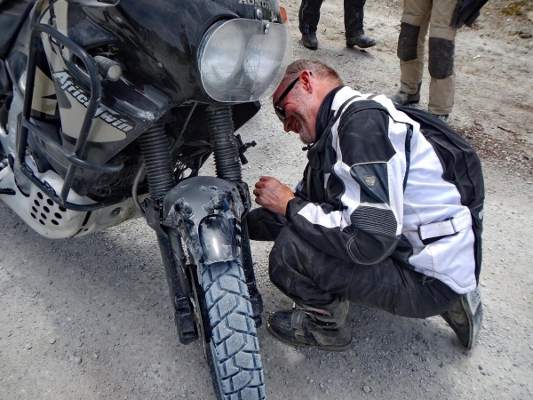 Neil was ANOTHER Africa Twin rider who had to show off how easy it was to fix one. The mudguard bolts had come loose and made a mess of the guard.