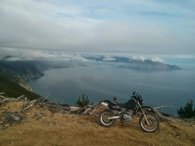 A DR650 looks out over Hori Bay