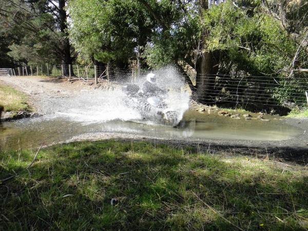 Honda Hornet crosses a water crossing in Lees Valley