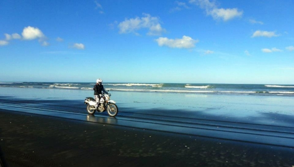 She Wolf riding Muriwai Beach