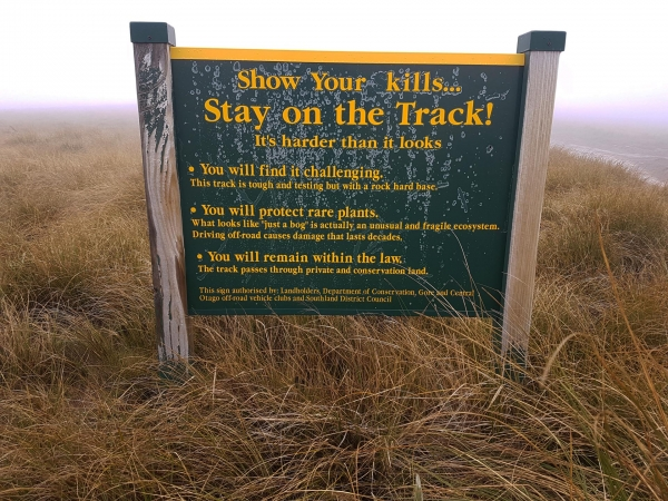 Warning sign by the hut at the peak of Piano Flat