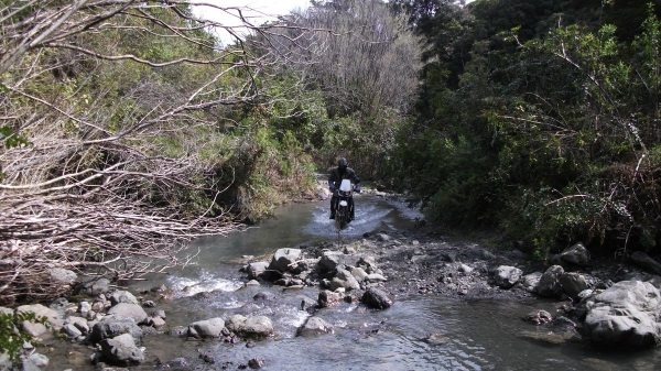 A rider crosses a stream on the way to Sutherlands Hut