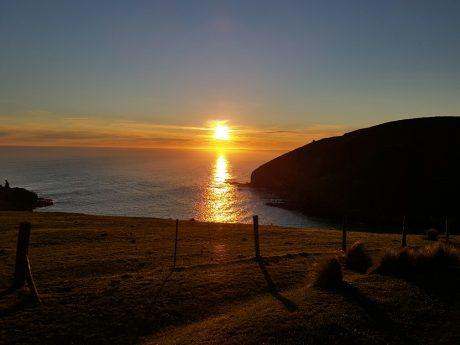 Sunset over Te Oka Bay