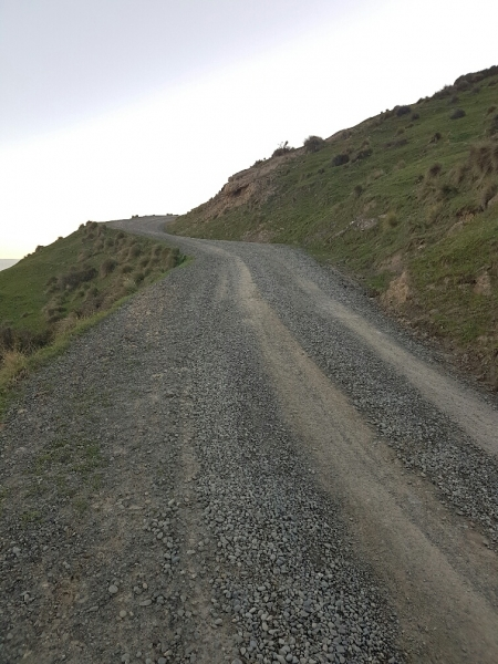 Steep sections and tight corners on Te Oka Bay Road