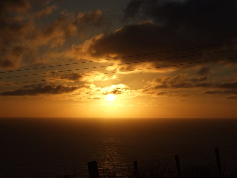 Sun setting over the Tasman Sea.